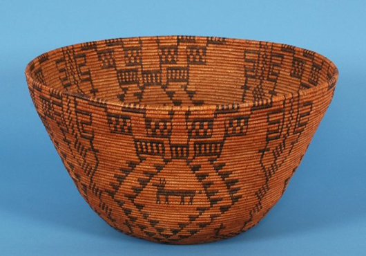 At 20 inches in diameter this Western Apache gathering basket was an armful. It is estimated at $6,900-$13,800. Image courtesy Seahawk Auctions.