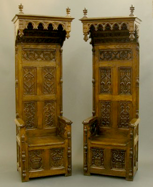 The pair of English Gothic Revival throne chairs with hooded tops stands 90 inches high. The lot has a $4,000-$6,000 estimate. Image courtesy Schmidt's Antiques.