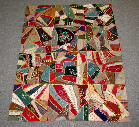 Made in West Virginia, this Victorian crib-size crazy quilt features embroidered cotton panels. Image courtesy Leland Little Auctions & Estate Sales and LiveAuctioneers archive.