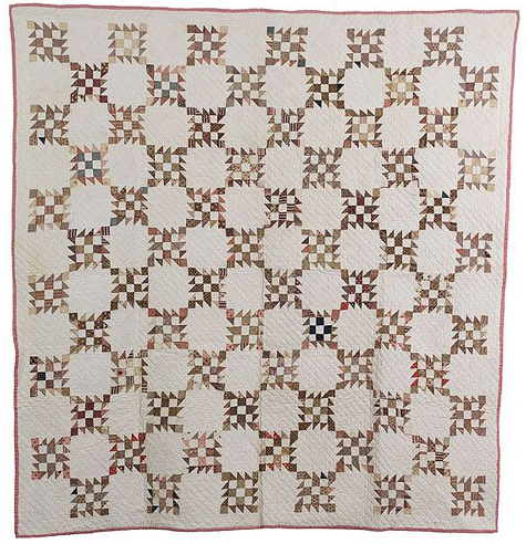 This Nine Patch with Flying Geese pattern quilt was entirely hand-sewn of cotton in the 1880s. It sold for $400 in June 2007. Image courtesy Cowan's Auctions Inc. and LiveAuctioneers archive.