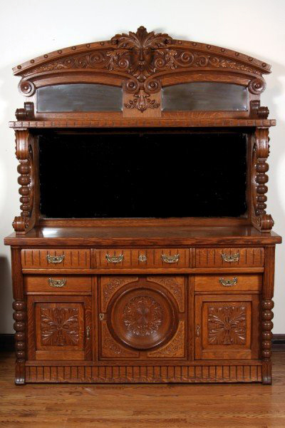 Late 19th/early 20th century Jacobean Revival oak server, American, estimate $1,000-$1,500. Image courtesy LiveAuctioneers.com and Stefek's.