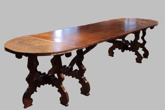 Baroque-style walnut trestle-base dining table, 8 feet long, estimate $1,000-$1,500. Image courtesy LiveAuctioneers.com and Stefek's.