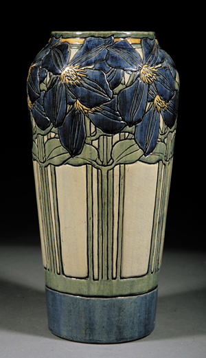 1904 Newcomb College high-glaze pottery vase decorated by Marie Hoa LeBlanc in the Clematis pattern, $169,200. Image courtesy Neal Auction Co.