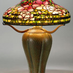 Circa-1910 Tiffany Studios table lamp with Peony shade on Peacock base. Provenance: descended in a Massachusetts family. Estimate $70,000-$90,000.