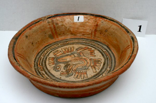 8½-inch by 2¼-inch bowl with red and black stripes on exterior and a highly conventionalized, plumed serpent on the inside. Origin Costa Rica. Estimate $40-$500. Image courtesy LiveAuctioneers.com and Old Barn Auction.