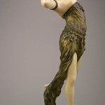 Atop a white onyx base this Art Nouveau figure by Fugere of bronze and carved ivory is 16 1/2 inches high. It has a $30,000-$40,000 estimate. Image courtesy Antique Place.