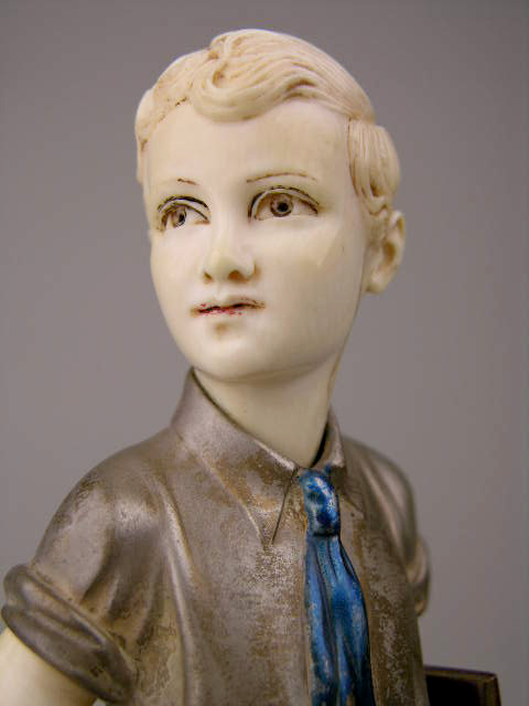 'F. Preiss' is signed on the base of this cold painted bronze and ivory figure. It is paired with a girl figure of the same size by the same artist. It has a $10,000-$15,000 estimate. Image courtesy Antique Place.