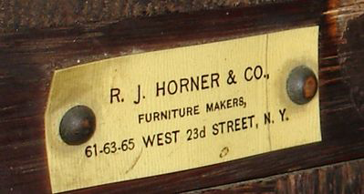 The correct oxidation appears under an R.J. Horner & Co. label on a corner cabinet from the turn of the 20th century. Image courtesy Fantasticantiques Inc. and LiveAuctioneers Archive.
