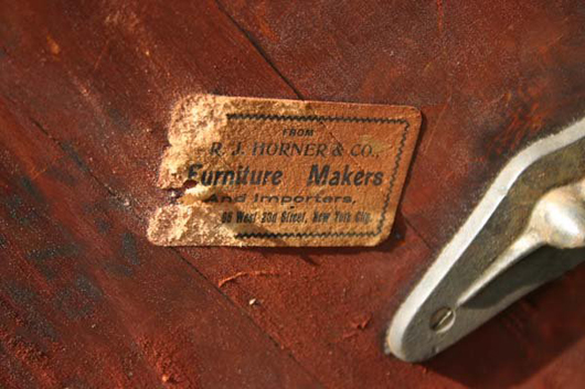 A chemical solvent likely damaged this R.J. Horner label affixed to a plain revolving bookcase. Image courtesy Stanton Auctions, Hampden, Mass., and LiveAuctioneers Archive.
