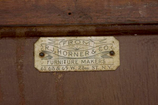 An R.J. Horner & Co. label is attached to an early 20th-century music cabinet having cabriole legs and an elaborately inlaid door. Image courtesy Leland Little Auction & Estate Sales and LiveAuctioneers Archive.