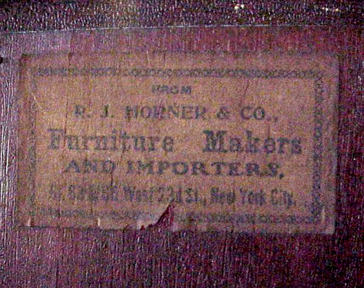 A paper label on the back of a Hepplewhite-style vitrine indicates R.J. Horner & Co. also imported goods. Image courtesy Rose Hill Auction Co. and LiveAuctioneers Archive.