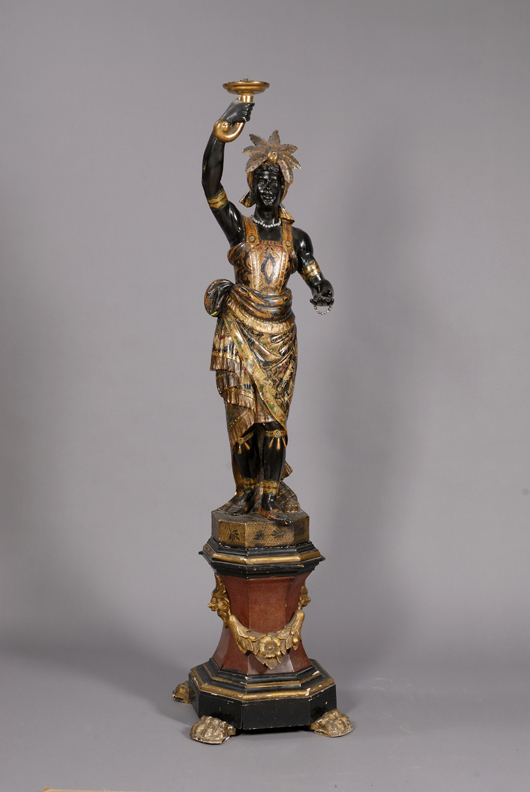 Large Venetian painted and parcel gilt carved wood and gesso blackamoor hall figure, late 19th century, 86¼ inches tall. Estimate $4,000-$6,000.