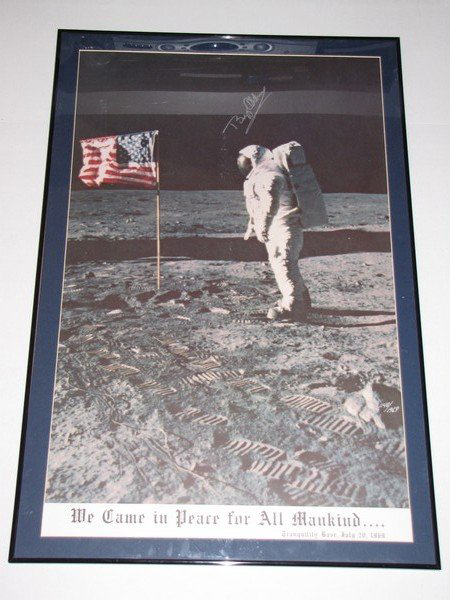 On the 40th anniversary of the first lunar landing, this 1969 poster autographed by astronaut Buzz Aldrin has a $300-$500 estimate. Image courtesy Bought IT Sold IT.