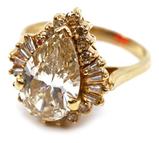 Set in 14-karat gold, the 4-carat pear cut diamond is rated VVS2 clarity and H in color. It has a $10,000-$15,000 estimate.