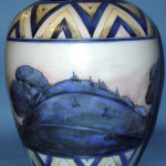 Moorcroft vase decorated in the Dawn Landscape motif. Height 15¾ inches. Estimate $4,000-$8,075. Image courtesy LiveAuctioneers.com and Potteries Specialist Auctions.