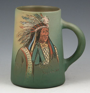 Weller's Dickens Ware Second Line, 1897-circa 1905, is marked by graffito decoration. The Indian chief mug is estimated at $500-$700. Image courtesy Belhorn Auction Services.