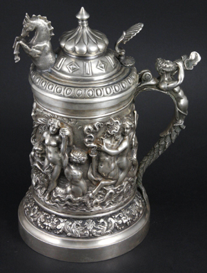 Silver tankard with ornate decoration, 10 inches tall, 43.9 troy oz. total weight. Estimate $5,000-$7,000. Image courtesy Kaminski Auctions.