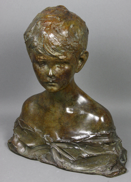 """Pavel Troubetskoy (Russian, 1866-1938), bronze sculpture of a boy. Signed and dated 1915 with foundry mark """"Roman Bronze Works,"""" 12.5 inches tall by 11 inches wide. Estimate $4,000-$6,000. Image courtesy Kaminski Auctions."""
