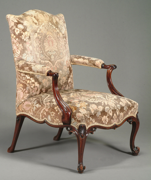 Fig. 2 - A George III carved mahogany 'Gainsborough' armchair, circa 1770, with carved outswept arms and slender carved cabriole legs, which fetched £110,000 ($164,200) at Dreweatts auction house in Newbury on July 15.