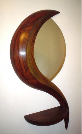 Sculptor Michael Coffey carved this mirror console for his Perceptions II series. The hanging mirror, 56 inches high, has a slide-open console shelf. Image courtesy Leighton Galleries.