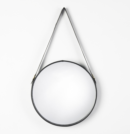 A circa-1965 Italian wall mirror in the manner of Jacques Adnet, made of vinyl, mirrored glass and brass, was estimated at $2,000-3,000. It sold for $125. Image courtesy Wright.