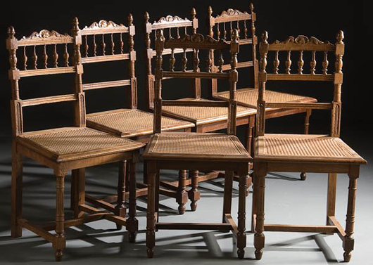 Six oak spool-turned side chairs with cane seats, circa 1900, to be auctioned by Jackson's International on Aug. 15. Estimate $150-$250. Image courtesy Jackson's International and LiveAuctioneers.com.