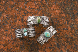 Wide silver bracelets with curio trade stamping and turquoise sold for $587.50 in Cowan's American Indian and Western Art Auction on April 4. Image courtesy Cowan's.
