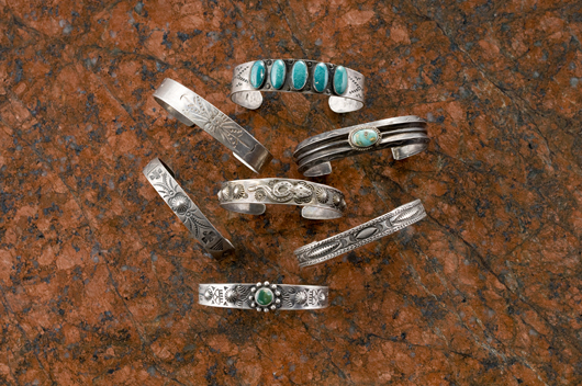 A lot of seven historic bracelets with curio trade stamping sold for $587.50 in Cowan's American Indian and Western Art Auction in April. Image courtesy Cowan's.