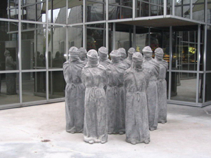 Statues collectively known as The Petrified, at entrance to The International Red Cross Museum in Geneva. Photo by Julia Lukmanova. Courtesy Wikimedia Commons.
