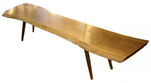 George Nakashima (1905-1990) coffee table, 16 inches high, 71 inches wide, 20 inches deep. A featured lot in Showplace Antique Center¹s Aug. 9 sale of art, industrial design and mid-century furniture. Estimate $15,000-$20,000. Image courtesy LiveAuctioneers.com and Showplace Antique Center.