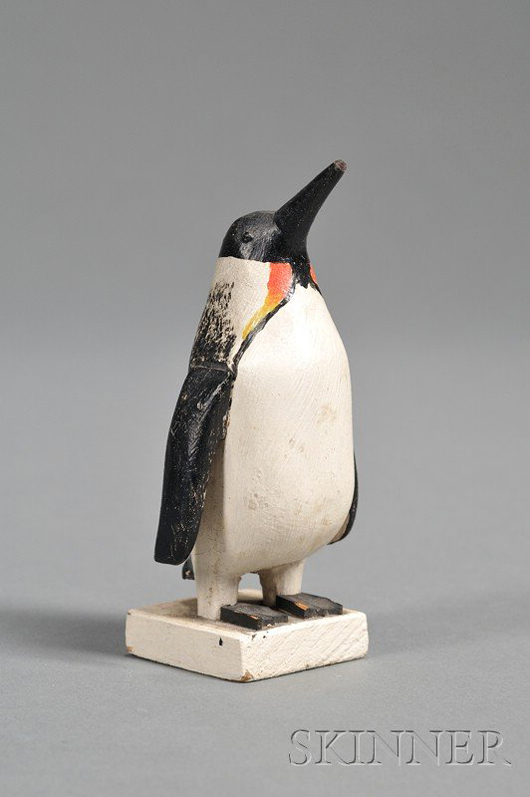 Lot 226 Small carved and painted emperor penguin figure, Charles Hart (1862-1960), Gloucester, Mass., c. 1935, est. $800-$1,200. Image courtesy LiveAuctioneers.com and Skinner Inc.