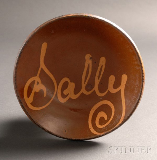 Lot 94 Redware plate with yellow slip inscription of the name Sally, 19th century, est. $2,500-$3,500. Image courtesy LiveAuctioneers.com and Skinner Inc.