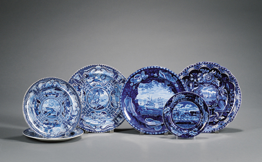 """This group of nine blue and white English plates made in the early 19th century would look perfect on a corner cupboard or plate rack. The collection sold at a June auction for $800. Views include a """"States"""" dinner plate by Clews and """"Commodore MacDonnough's Victory"""" by Enoch Wood & Sons. Courtesy Skinner Inc."""
