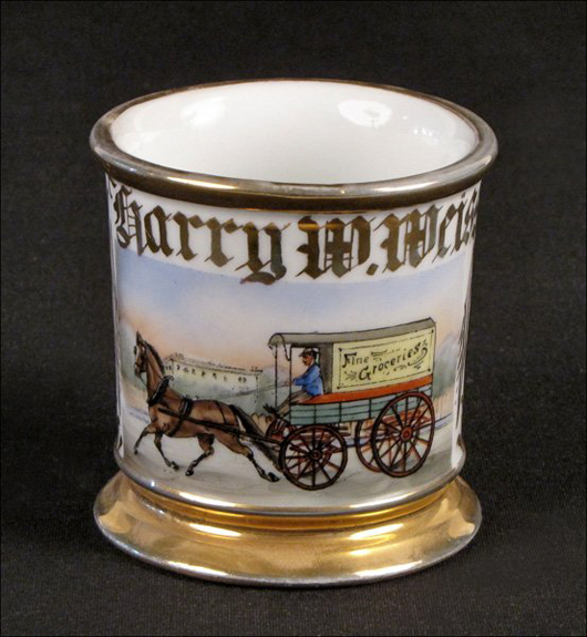 The most desirable occupational shaving mugs are decorated with hand-painted scenes depicting Main Street America. This grocer's mug has a $500-$700 estimate. Image courtesy Susanin's.