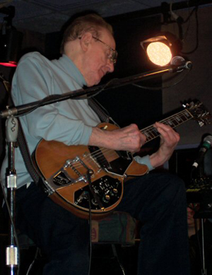 Les Paul at a live gig on May 31, 2004, playing one of his eponymously named guitars. Image courtesy Wikimedia Commons.