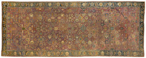 The foremost carpet in the sale is this palace-size 17th-century Indo-Persian with elegantly drawn compartments around the perimeter. In a rich array of colors with silk-wrapped selvedge, it is projected to bring $40,000 to $80,000. Image courtesy Brunk Auctions.