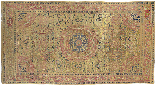 Estimated at $30,000 - $60,000 is this 17th-century Ottoman-style carpet with a blue, red and gold central medallion. The corners contain a quarter arc with the central medallion design repeated, a 17th-century Persian design element. Other features, notably the use of red and green, suggest a strong Egyptian influence. Image courtesy Brunk Auctions.