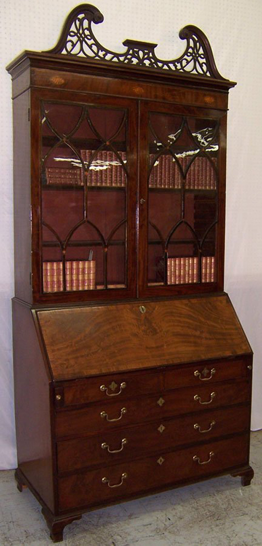 18th-century mahogany fall-front glass door secretary with fretwork top, estimate $2,750-$4,000. Image courtesy LiveAuctioneers.com and Langston Auction Gallery.