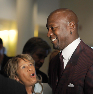 2009 Basketball Hall of Fame inductees C. Vivian Stringer and Michael Jordan share a laugh at the Grey Flannel Auctions reception. Copyrighted photo by Chuck Miller. Courtesy Grey Flannel Auctions.