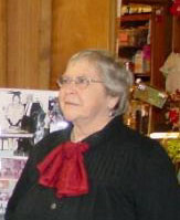 Marjorie Darrah in a photograph taken on Dec. 31, 2005 at an on-site farewell party for the Mary Merritt Doll & Toy Museum. Photo copyright Catherine Saunders-Watson.