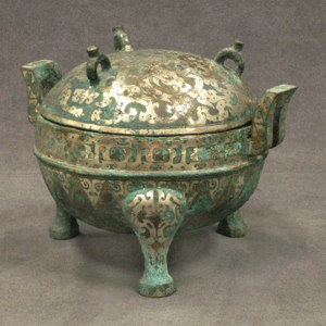 Accented with silver inlay, this bronze Chinese vessel known as a ding dates to the Han Dynasty. Image courtesy William J. Jenack Auctioneers.