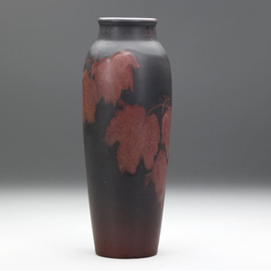 Rookwood 1903 painted matte vase by Olga G. Reed, 11¼ inches, with red maple leaves on a shaded indigo ground, estimate: $2,000-$3,000. Image courtesy Rago's.