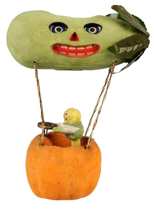 Rare Halloween jack-o-lantern depicting veggie man piloting a pickle-shape hot air balloon. Estimate $3,000-$4,000. Image courtesy Morphy Auctions.