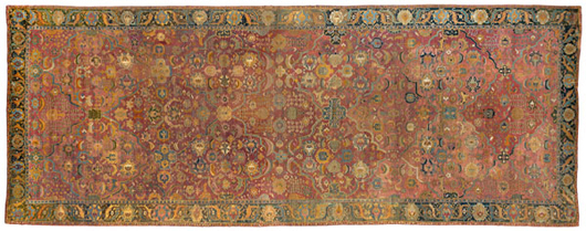 This palace-size 17th century Indo-Persian with elegantly drawn compartments around the perimeter was one of 34 carpets deaccessioned by Tryon Palace, North Carolina. In a rich array of colors with silk-wrapped selvedge, it brought $57,500.