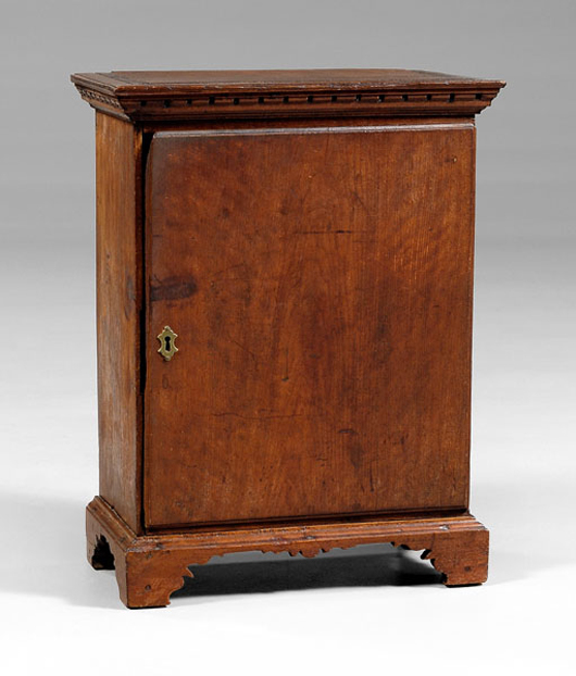 """This circa 1770 Chippendale spice chest in walnut with poplar secondary was originally purchased in Petersburg, Virginia. The unusual 23 ¾"""" by 17 ¼"""" by 9 ½"""" chest deaccessioned by MESDA of Winston-Salem, North Carolina, brought $12,650."""