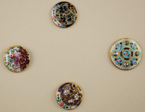 These antique enameled buttons are pierced and embellished with cut steel. The lot of four sold for $40 at a button auction in March. Photo courtesy Bella Button Auctions and LiveAuctioneers archive.
