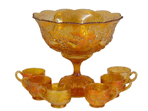 Millersburg (Ohio) carnival glass punch set, multi-fruit pattern, includes six cups. Made circa 1910-1912, the brief period during which Millersburg produced carnival glass. Estimate $2,000-$2,200. Image courtesy The Antiques Auction Gallery.