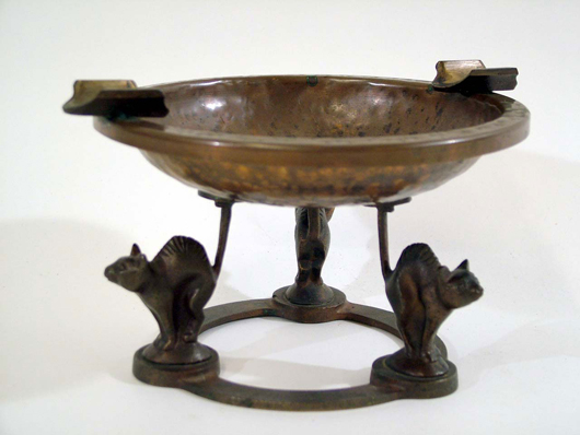 Carl Sorensen, hammered-copper ashtray, late 19th century. Cats with arched backs form base. Estimate $600-$650. Image courtesy The Antiques Auction Gallery.