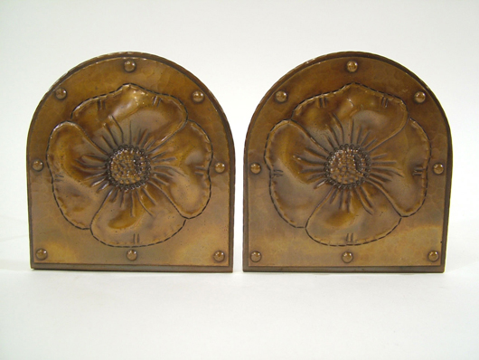 Roycroft 'Poppy' Arts & Crafts bookends with mark from mid to late 1920s, 5¾ inches tall. Estimate $650-750. Image courtesy The Antiques Auction Gallery.