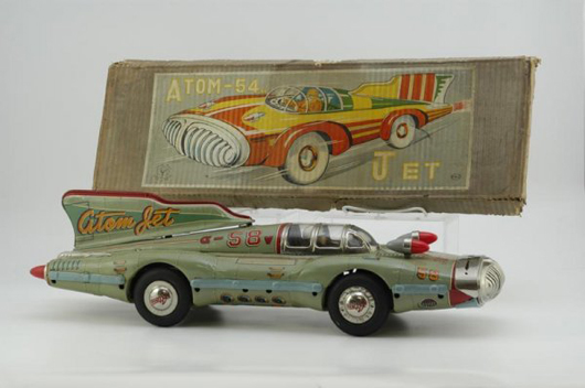 Boxed futuristic Atom Jet tin racer by Yonezawa, 1950s, 26 1/2 inches long, sold through LiveAuctioneers.com for $22,895 against an estimate of $4,000-$6,000. Image courtesy LiveAuctioneers.com and Bertoia Auctions.